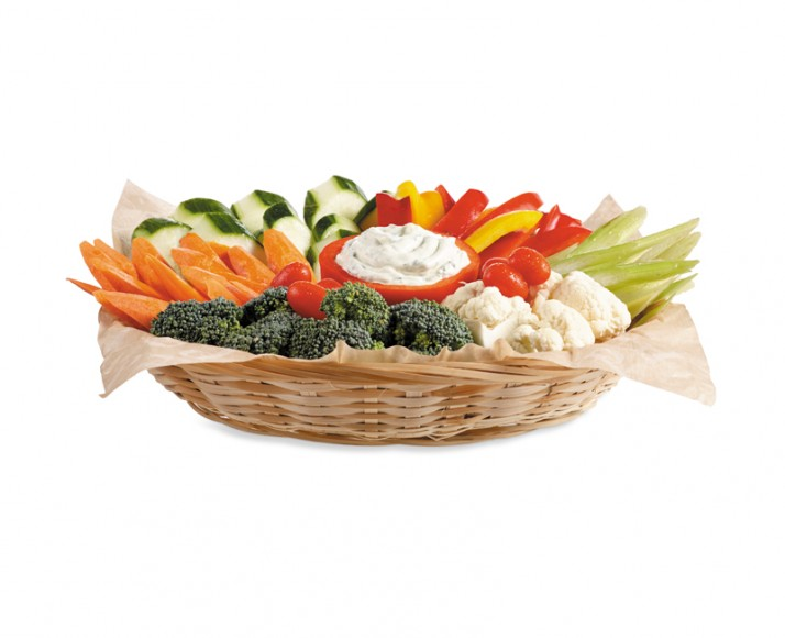 Basket of fresh vegetables and dip