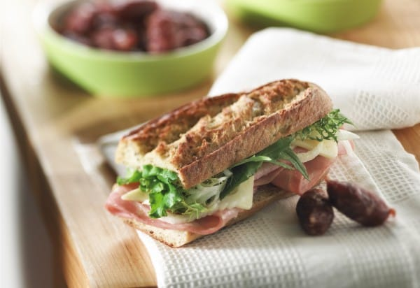 Ham simmered in broth, fennel and cheese sandwich