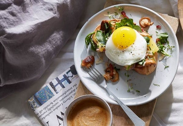 Open-faced sandwich with mushrooms and fried egg
