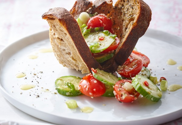 Cucumber, tomato and hamp salad on a bread nest